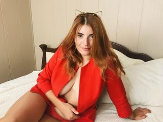 I like to listen music, draw and cook ) Hot games together , creative clothes ) - I am redhead girl with big breasts and nice body. If you want me to perform it for you i am waiting here in my room. Come to me dear  ;)